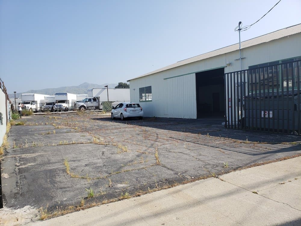 Main gate view of a commercial property at 3321 Burton Ave